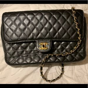 Chanel black leather flap bag. Black and gold